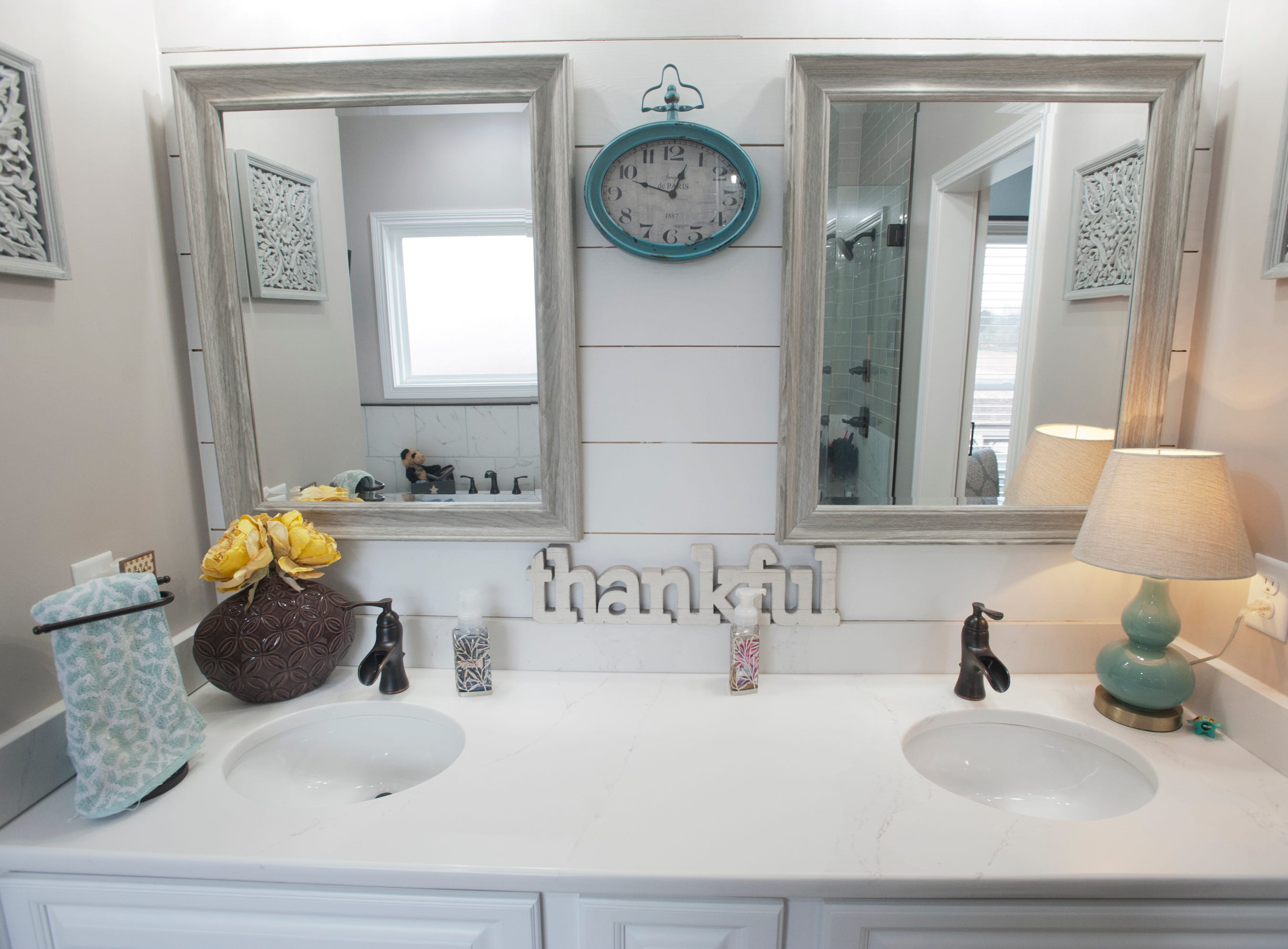 The master bathroom with double-sinks and shiplap backsplash.