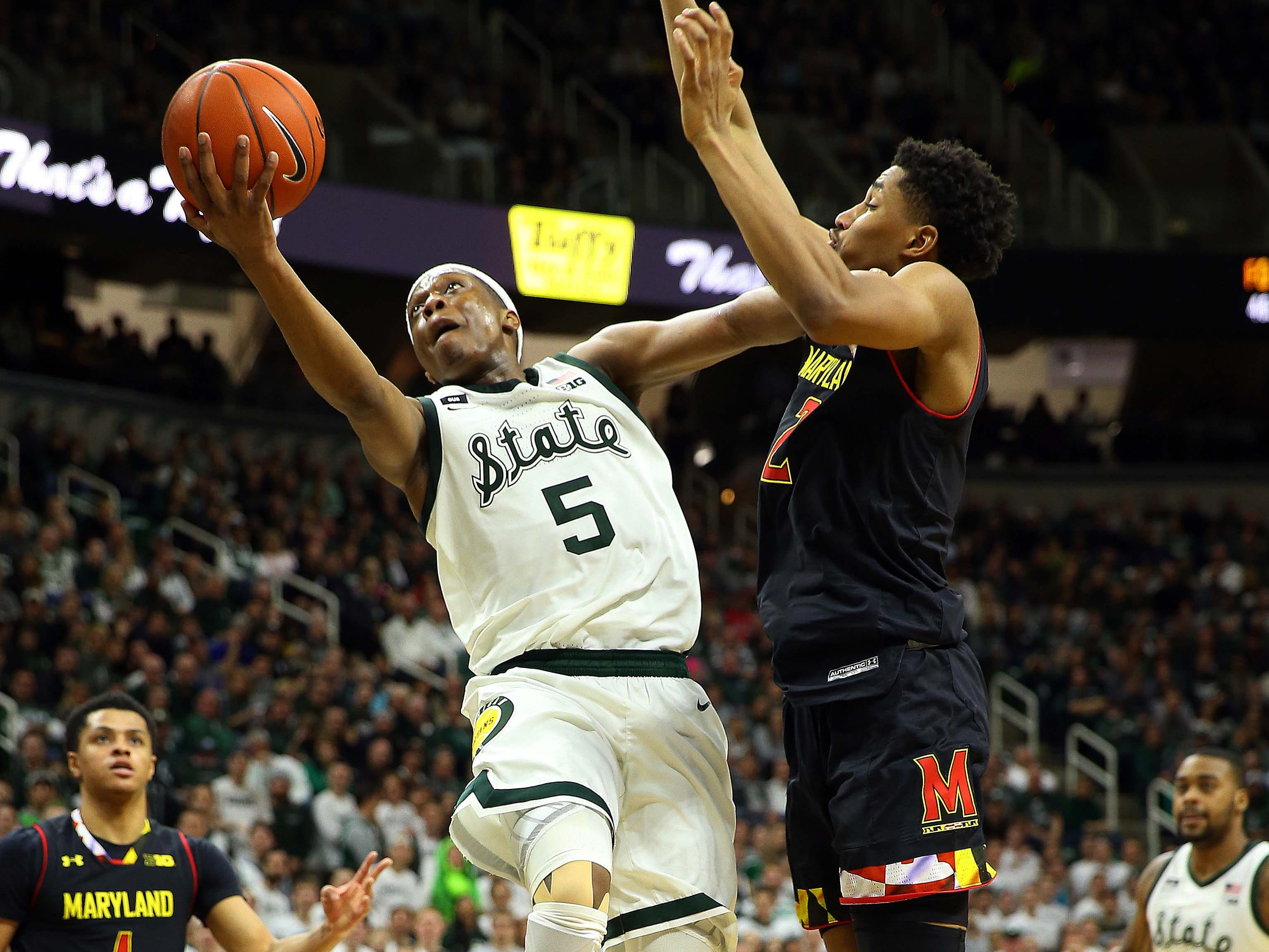 Michigan State Spartans guard Cassius Winston (5) drives to the basket against Maryland Terrapins guard Aaron Wiggins (2) during the first half of a game at the Breslin Center.