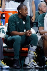 Michigan State's Joshua Langford sits on the bench in a walking boot during the second half of an NCAA college basketball game against Maryland, Monday, Jan. 21, 2019, in East Lansing, Mich. Michigan State won 69-55.