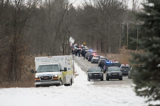 Emergency responders at the scene off of Woodbury Road south of Interstate-69, Tuesday, Jan. 22, 2019. State Police said Shiawassee County deputies shot and took into custody a man wanted in the shooting of a Saginaw area police officer earlier Tuesday.