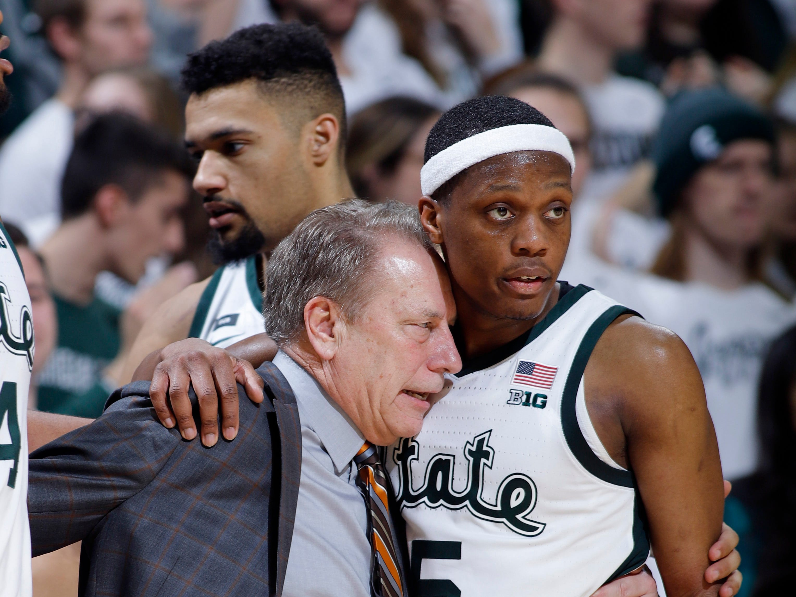 Michigan State coach Tom Izzo, left, talks with Cassius Winston during the second half of an NCAA college basketball game Maryland, Monday, Jan. 21, 2019, in East Lansing, Mich. Michigan State won 69-55.
