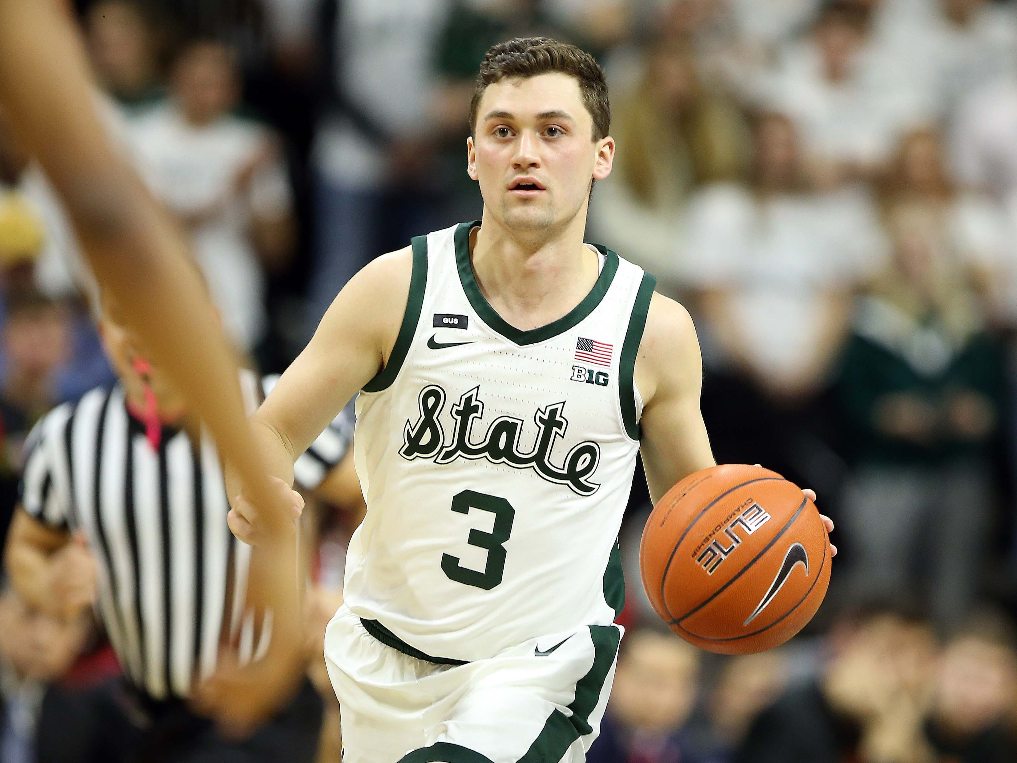 Michigan State Spartans guard Foster Loyer (3) brings the ball up court during the second half of a game against the Maryland Terrapins at the Breslin Center.