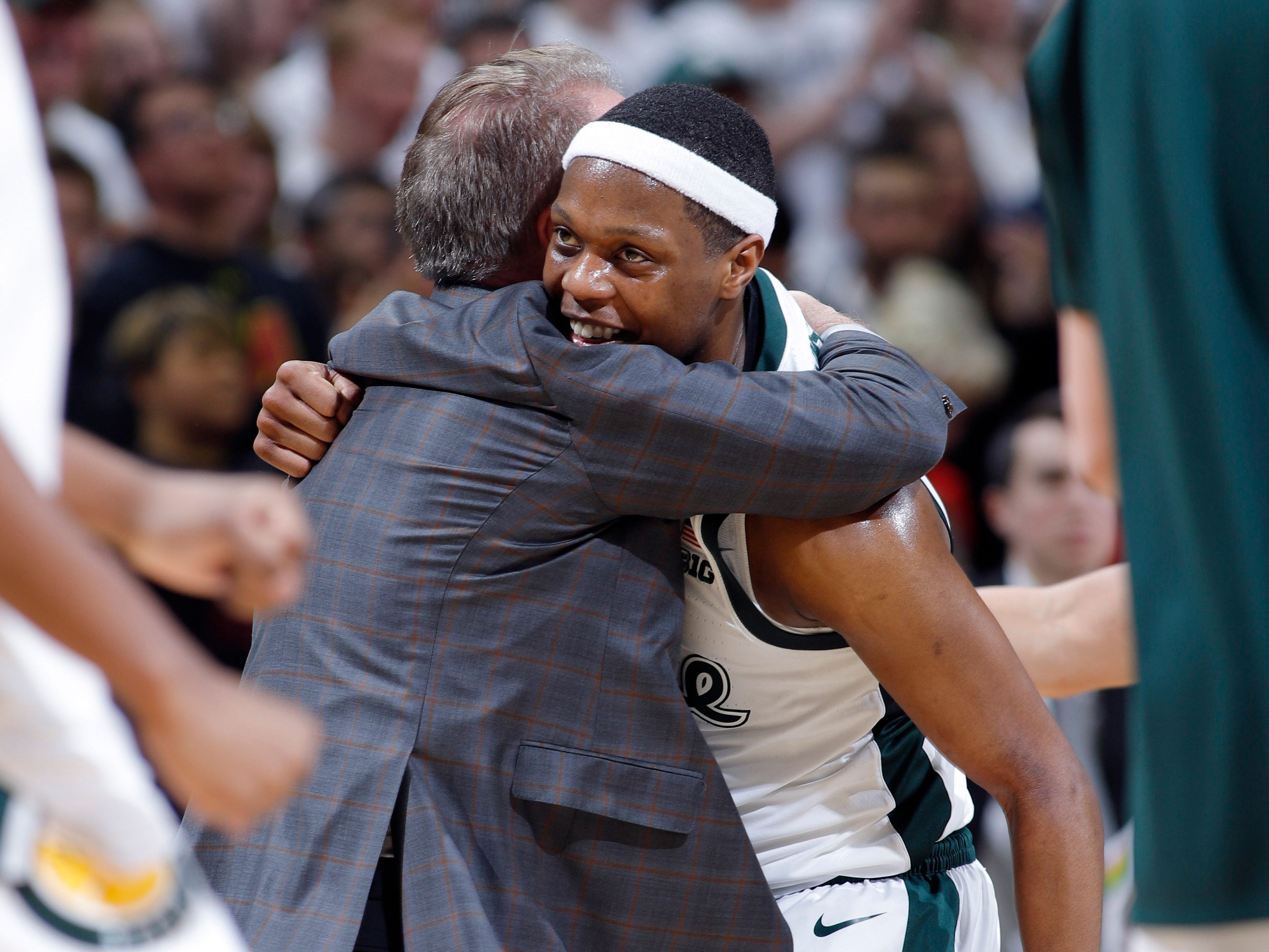 Michigan State coach Tom Izzo, left, hugs Cassius Winston during a timeout the second half of an NCAA college basketball game against Maryland, Monday, Jan. 21, 2019, in East Lansing, Mich. Michigan State won 69-55.