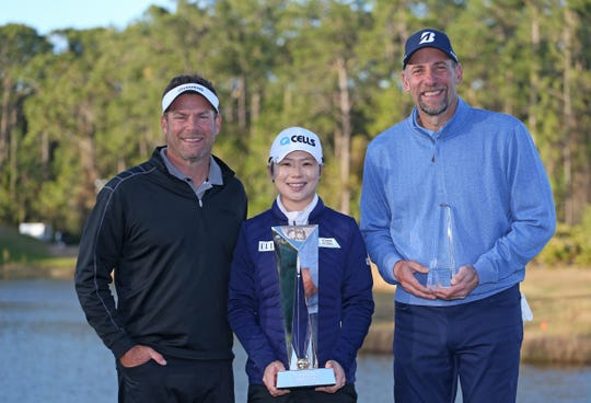 Diamond Resorts CEO Michael Flaskey, Eun-Hee Ji of South Korea and Celebrity Tournament winner former MLB pitcher John Smoltz after the Diamond Resorts Tournament of Champions at Tranquilo Golf Course at Four Seasons Golf and Sports Club Orlando on January 20, 2019 in Lake Buena Vista, Florida.