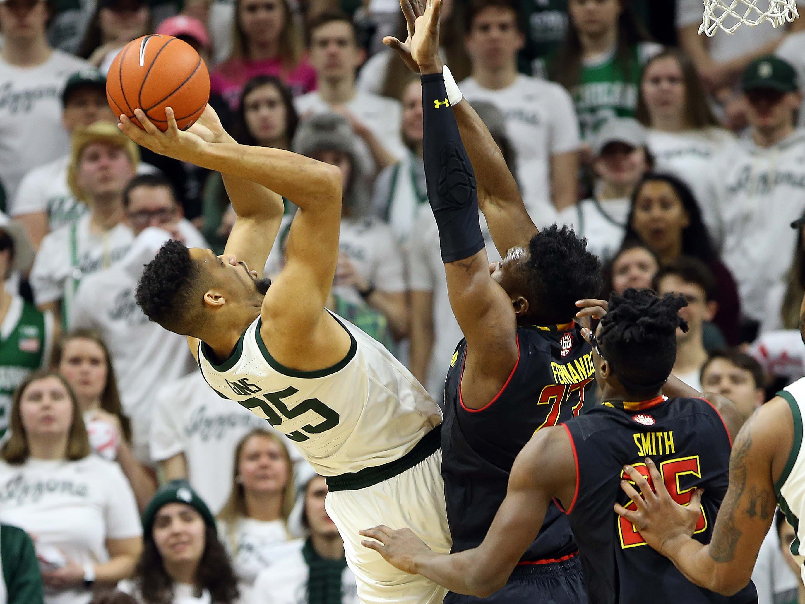 Michigan State Spartans forward Kenny Goins (25) is defended by Maryland Terrapins forward Bruno Fernando (23) during the first half of a game at the Breslin Center.