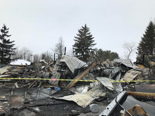Yellow caution tape surrounded the remains of Sundance Chevrolet's body shop near Grand Ledge on Tuesday, Jan. 22, 2019. A fire destroyed the structure on Saturday, Jan. 19, 2019.