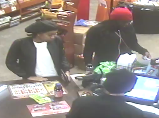 Marshfield police are trying to identify the woman in the black cap in  connection with two counterfeit $100 bills used at a Marshfield convenience store.