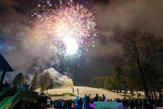 Patrons of Snow Trails watch fireworks at last year's mid-season party.