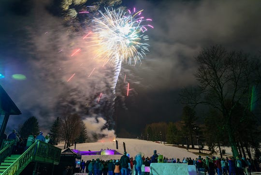 Patrons watch fireworks from the base of Mt. Mansfield at last year's mid-season party at Snow Trails.