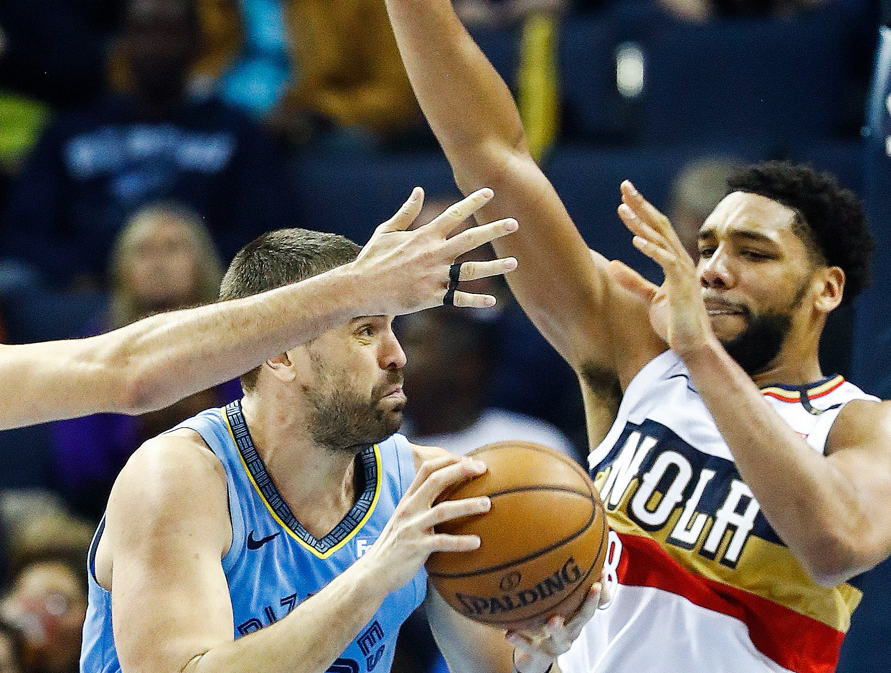 Memphis Grizzlies center Marc Gasol (left) drives the lane against New Orleans Pelicans defender Jahlil Okafor (right) during action at the FedExForum in Memphis, Tenn., Monday, January 21, 2019.