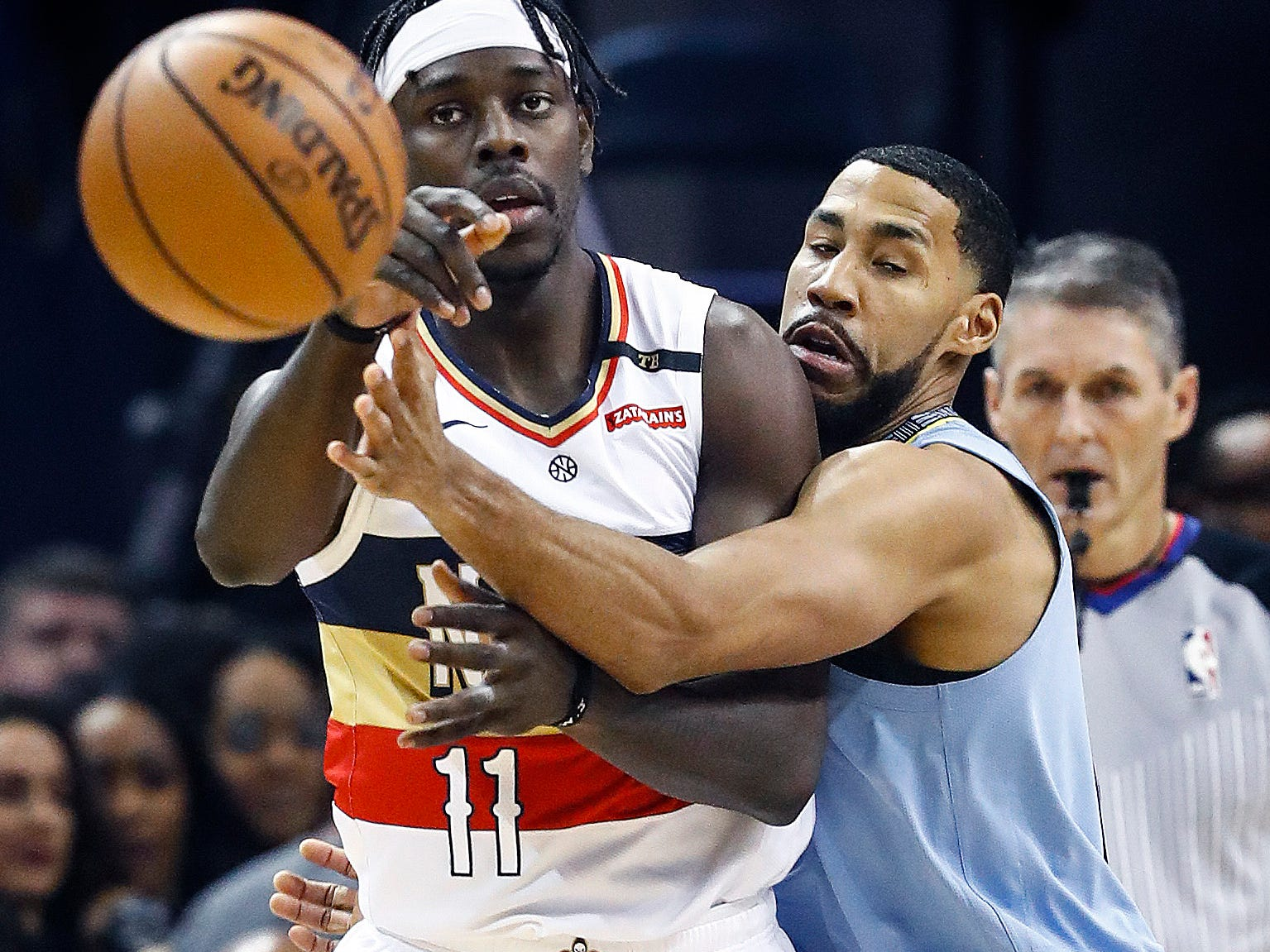 Memphis Grizzlies defender Garrett Temple (right) applies defensive pressure to New Orleans Pelicans guard Jrue Holiday (left) during action at the FedExForum in Memphis, Tenn., Monday, January 21, 2019.