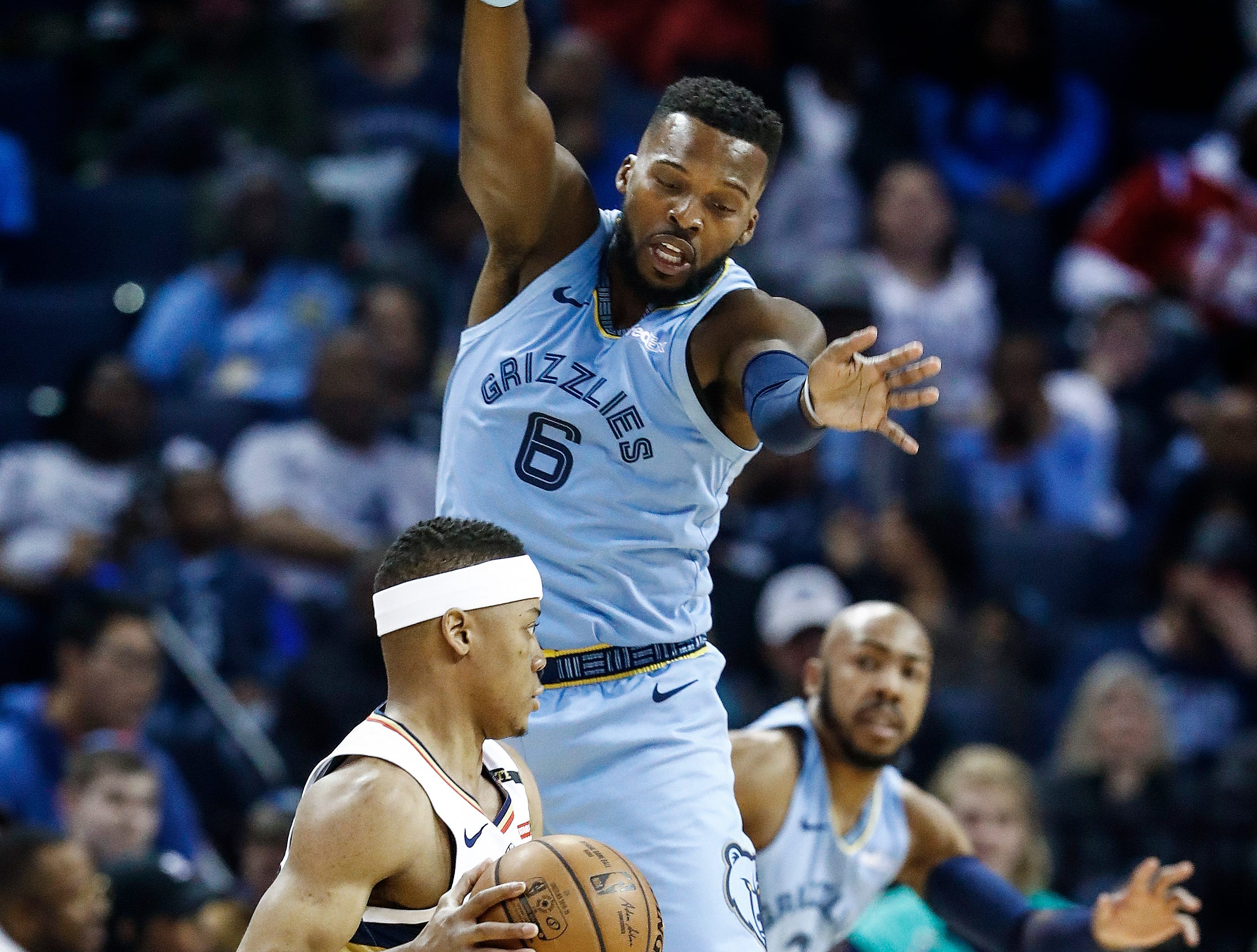 Memphis Grizzlies defender Shelvin Mack (top) looks to stop New Orleans Pelicans guard Tim Frazier (bottom) during action at the FedExForum in Memphis, Tenn., Monday, January 21, 2019.