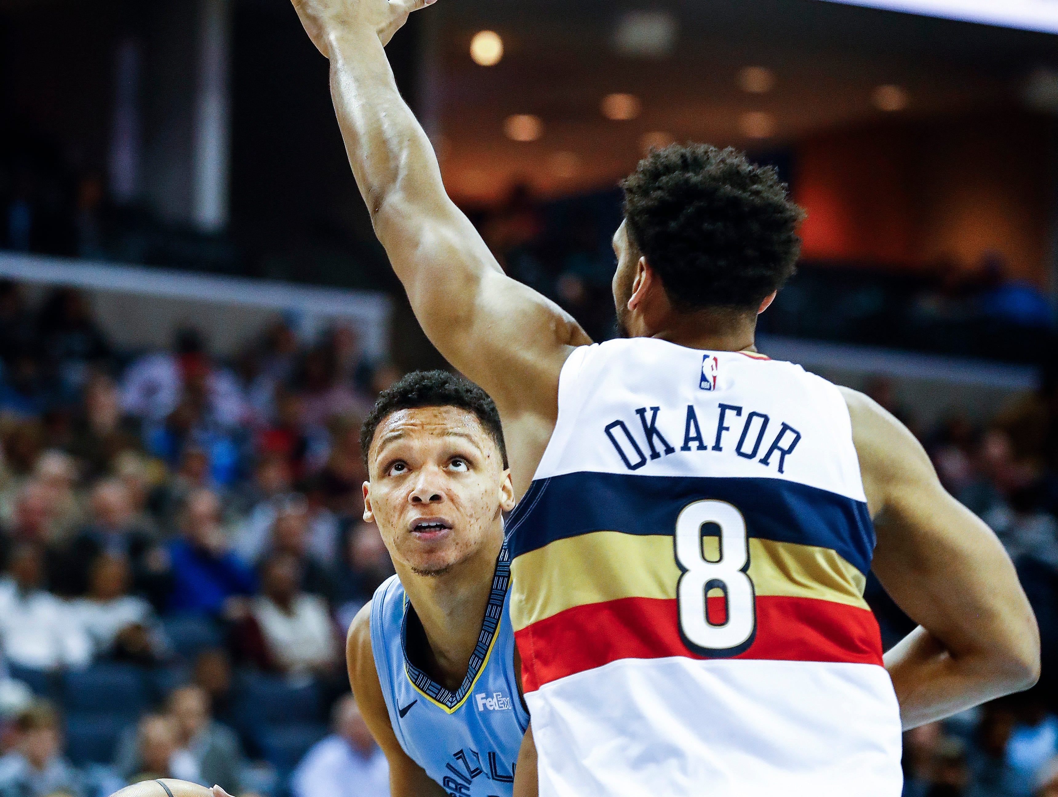 Memphis Grizzlies forward Ivan Rabb (left) looks for his shot against New Orleans Pelicans defender Jahlil Okafor (right) during action at the FedExForum in Memphis, Tenn., Monday, January 21, 2019.