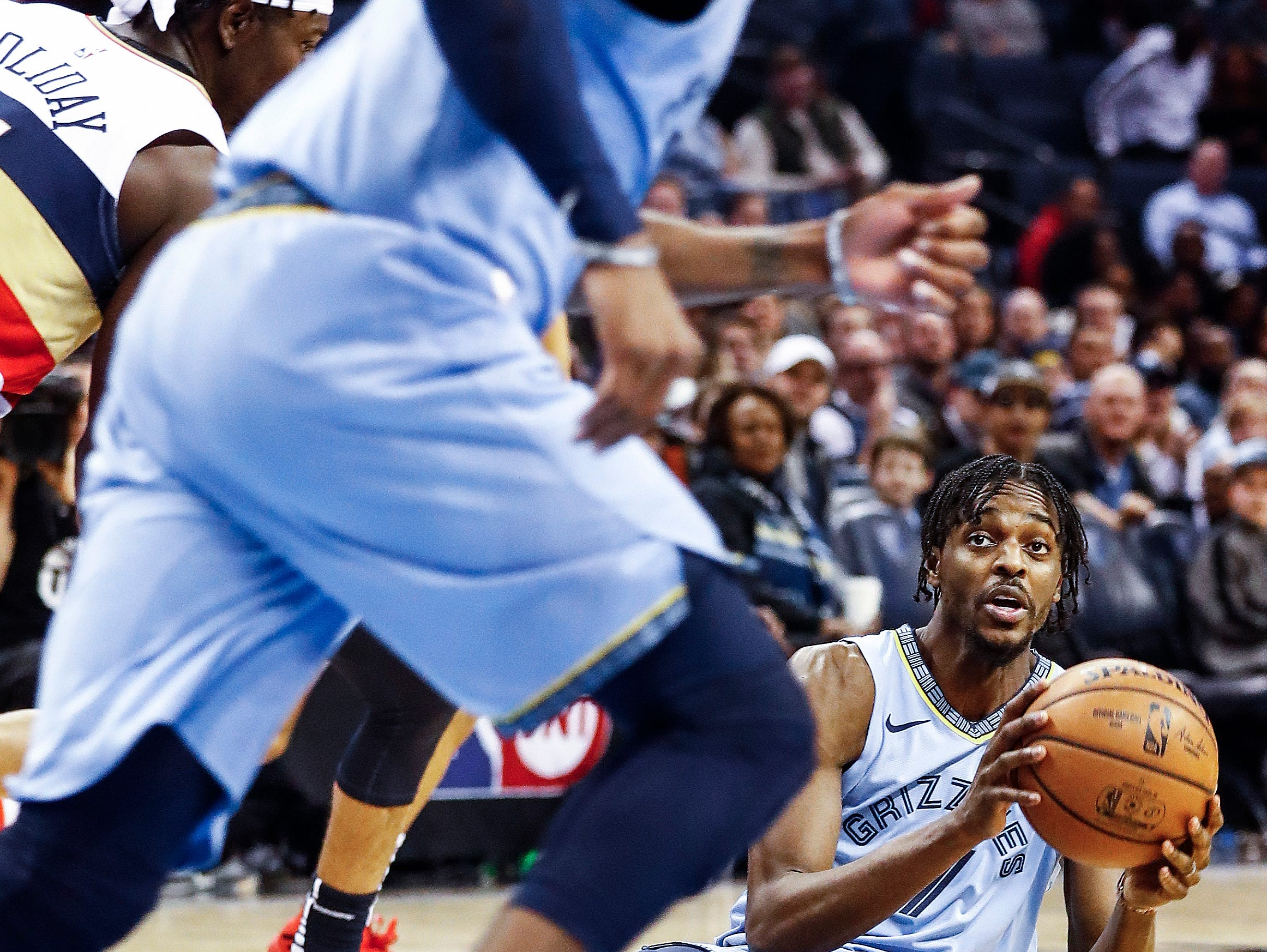 Memphis Grizzlies guard Justin Holiday (right) looks to make a pass after grabbing a loose ball during action against New Orleans Pelicans at the FedExForum in Memphis, Tenn., Monday, January 21, 2019.