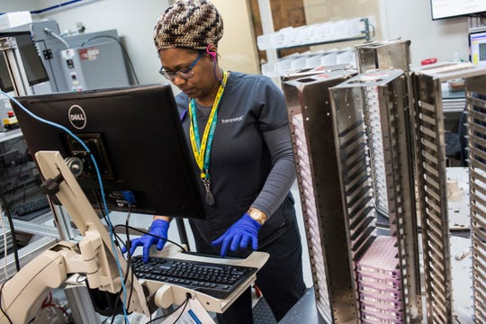 January 22 2019 - DeNisha Washington, lab technician at Transnetyx, at Transnetyx in Cordova on Tuesday. Tranxnetyx provides outsourced genotyping services and can detect mutations in mice, zebrafish, rabbits, ferrets, goats and rats.