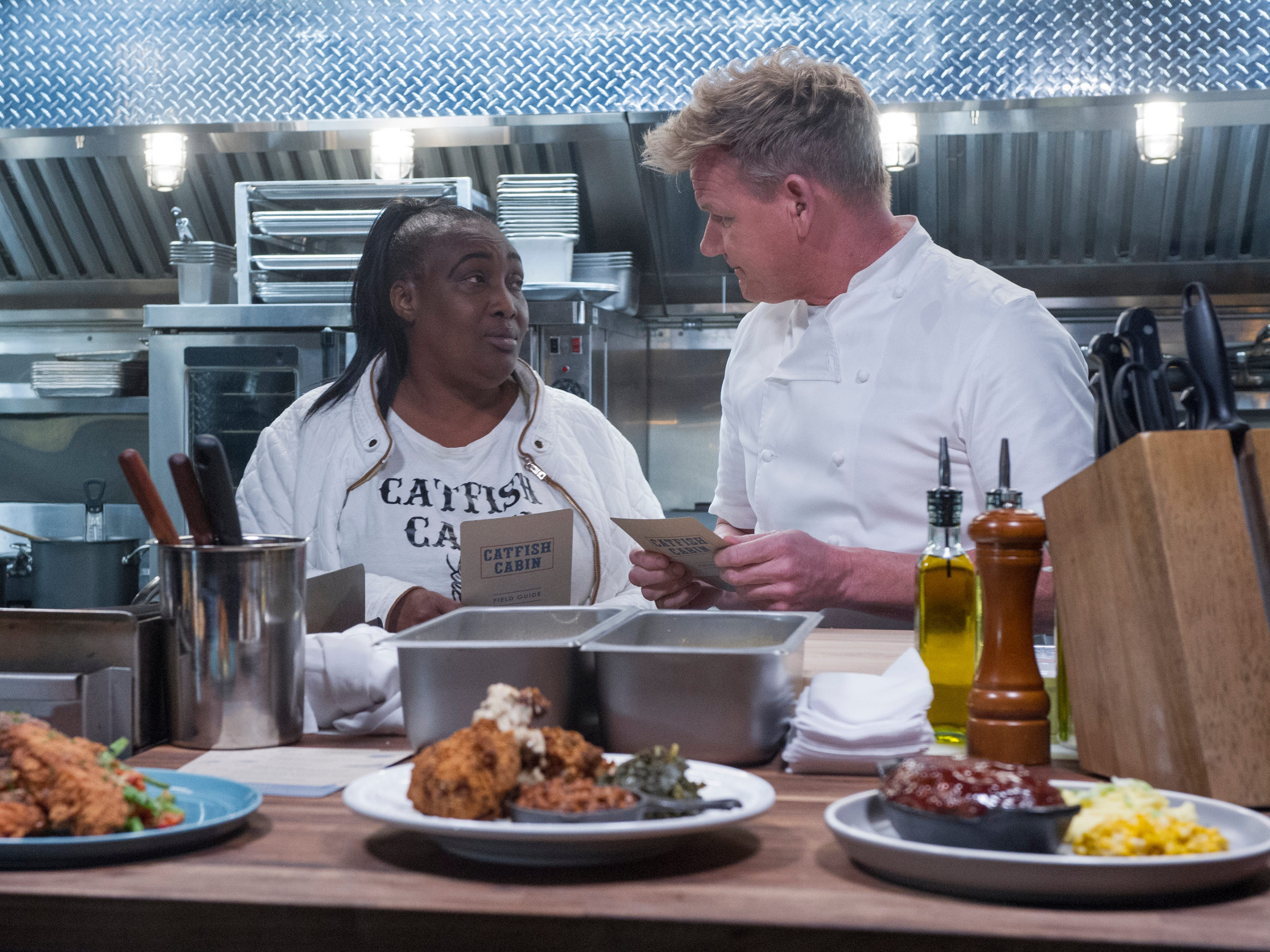 "Chef and host Gordon Ramsay, right, with the staff of Catfish Cabin in an episode of ""24 Hours to Hell and Back."""
