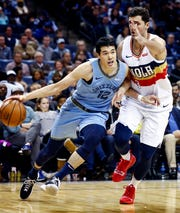 Memphis Grizzlies forward Yuta Watanabe (left) drives the lane against New Orleans Pelicans defender Nikola Mirotic (right) during action at the FedExForum in Memphis, Tenn., Monday, January 21, 2019.