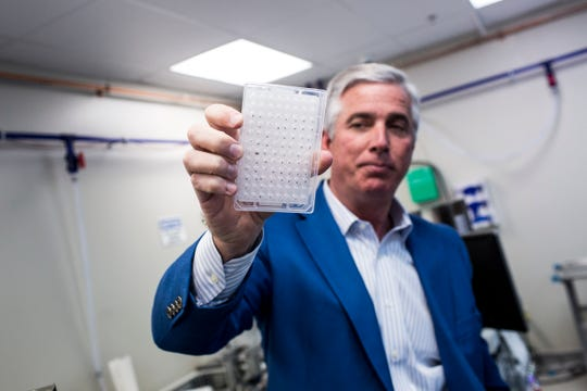 January 22 2019 - Bob Bean, the president of Transnetyx in Cordova, holds up a tray of samples. Tranxnetyx provides outsourced genotyping services and can detect mutations in mice, zebrafish, rabbits, ferrets, goats and rats.