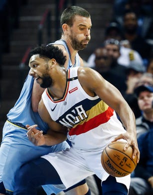 Memphis Grizzlies defender Marc Gasol (back) applies defensive pressure to New Orleans Pelicans forward Jahlil Okafor (front) during action at the FedExForum in Memphis, Tenn., Monday, January 21, 2019.