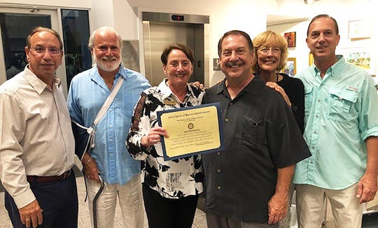 Pat Rutledge of the Noontime Rotary Club presents the 2019 Spirit of Marco Island Award to Jim Richards. From left, Al Diaz, Gene Donofrio, Rutledge, Richards, Linda Sandlin and Mike Richards.