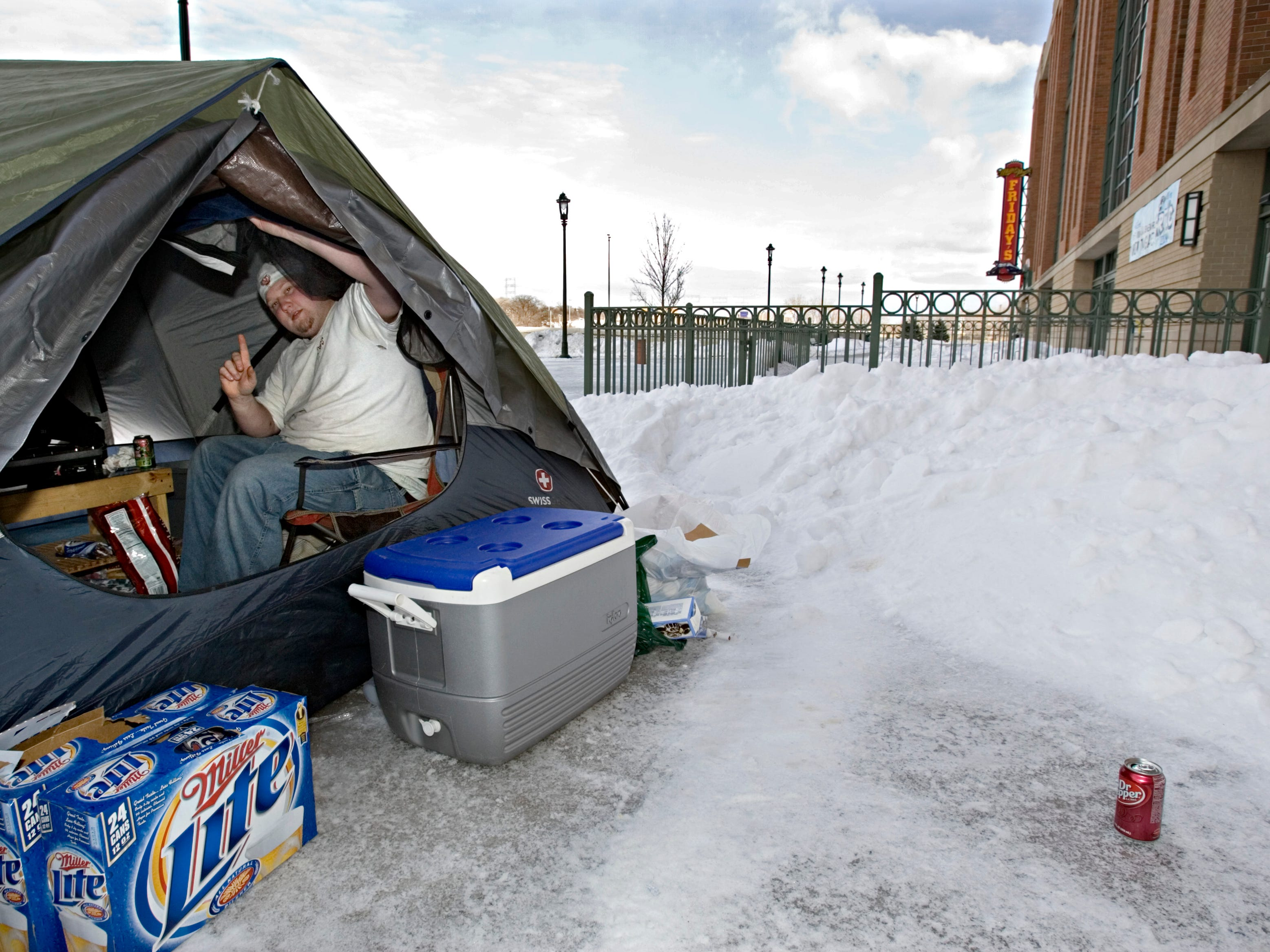 Jared Schuld of Fort Atkinson signals on Thursday, Feb. 21, 2008, that he is the first one in line to buy Milwaukee Brewers tickets when they go on sale.