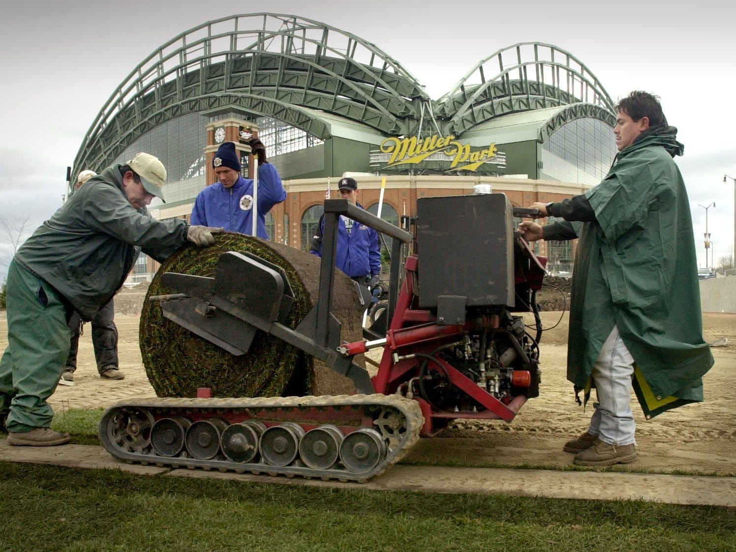 Manuel Orozco, right, and Jesus Galvan, left, of American Sod, and Miller Park grounds crew members lay sod at the youth baseball facility on the old County Stadium grounds Monday morning, Nov. 19, 2001. The $3.1 million facility will be known as Helfaer Field. Supporters say the facility, which is expected to open next Memorial Day, will be one of the premier youth baseball facilities in the country.