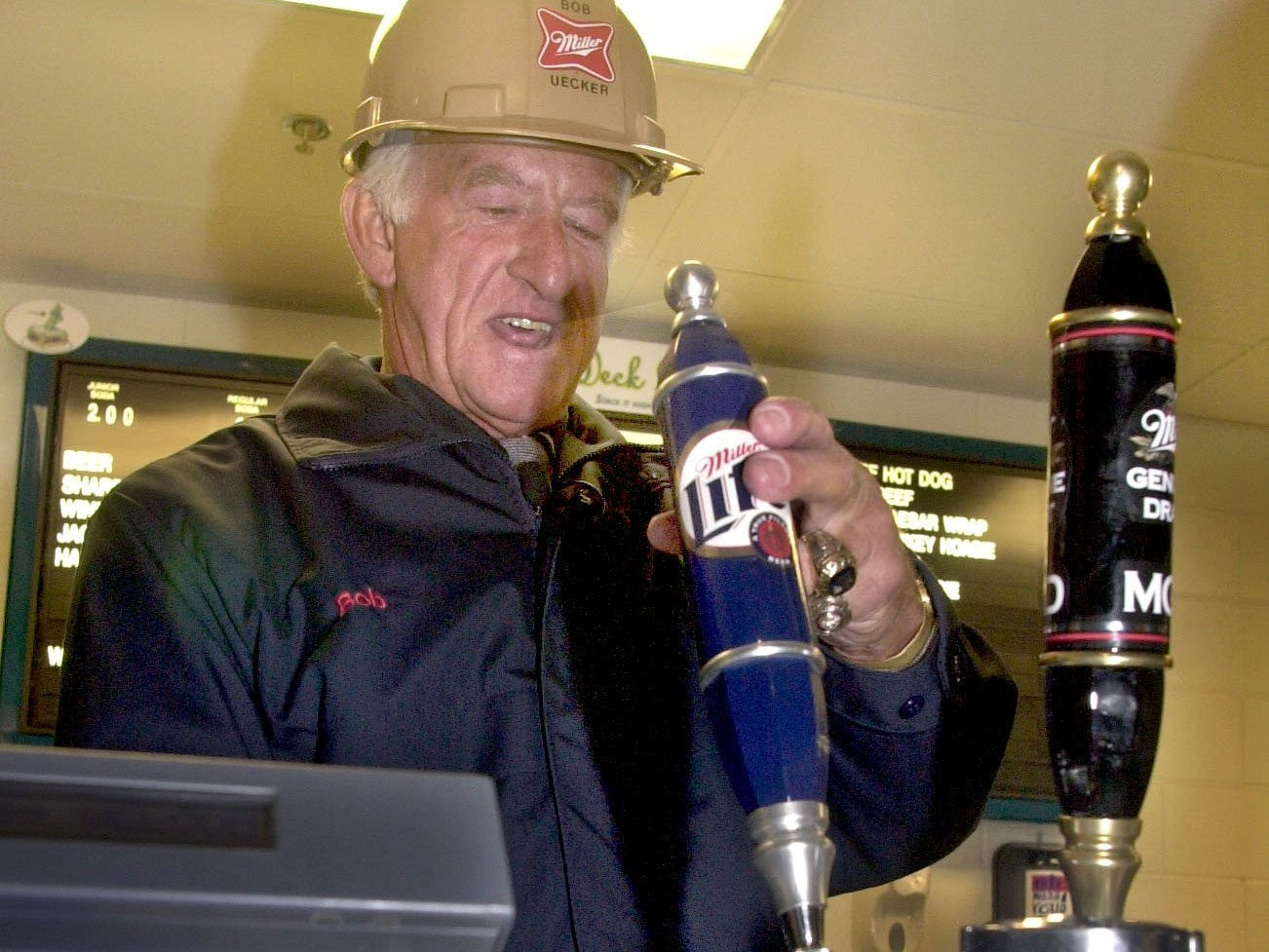 Bob Uecker draws the first beer at a concession stand in Miller Park Thursday, March 28, 2001.