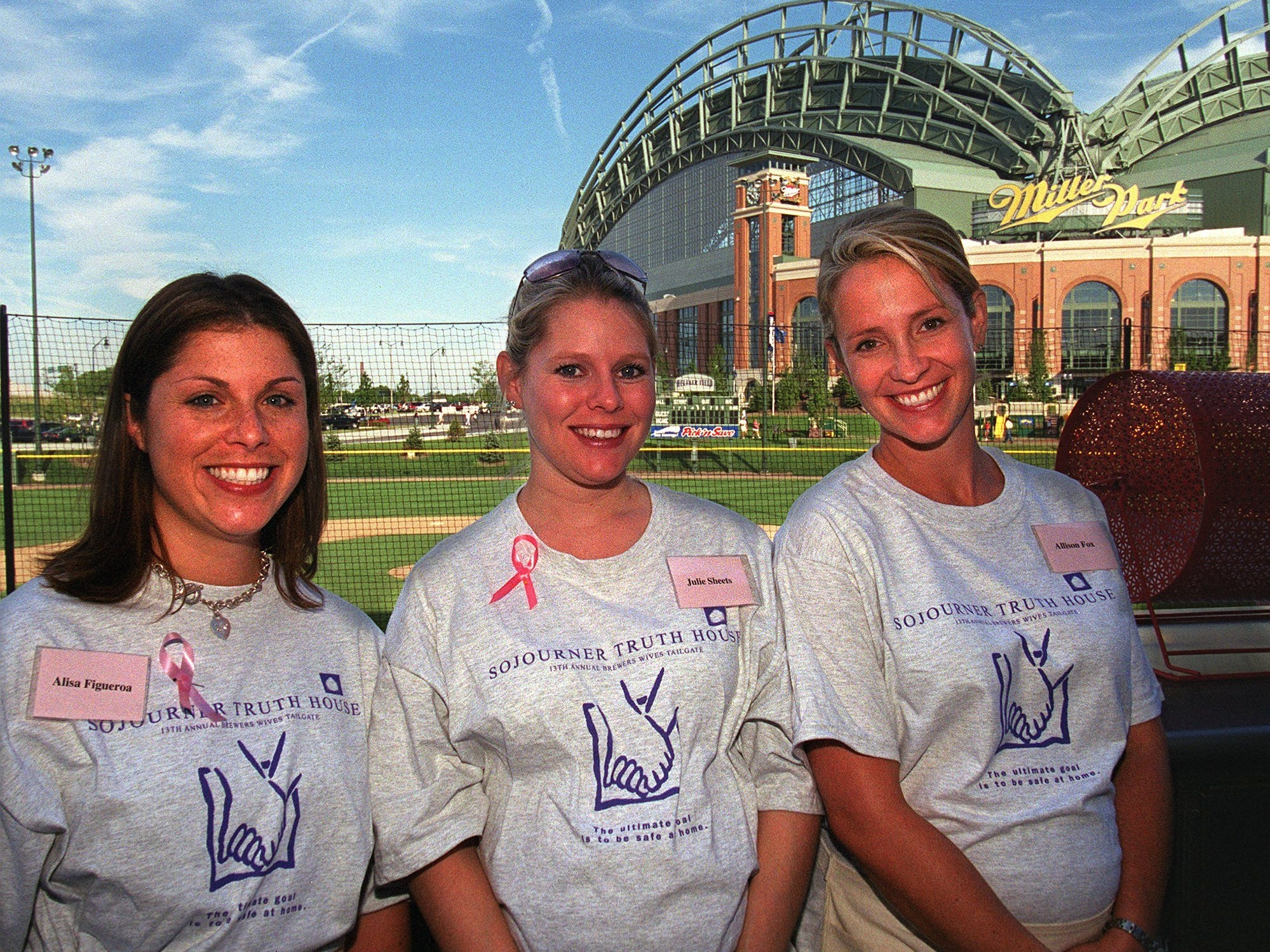 Alisa Figueroa, left, Julie Sheets, center, and Allison Fox appear at a benefit for the Sojourner Truth House held at Helfaer Field Friday, July 12, 2002, in Milwaukee.