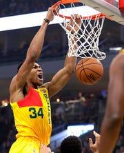 Bucks forward Giannis Antetokounmpo throws down a dunk against the Mavericks on Monday.