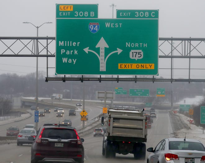 A highway exit sign on I-94 West says Miller Park Way, leading to Miller Park in Milwaukee on Tuesday, Jan. 22, 2019. With the name of Miller Park changing to American Family Field, the city of Milwaukee has approved changing the name of Miller Park Way to Brewers Boulevard. But the village of West Milwaukee has not given approval to change the roadway's name in the village.