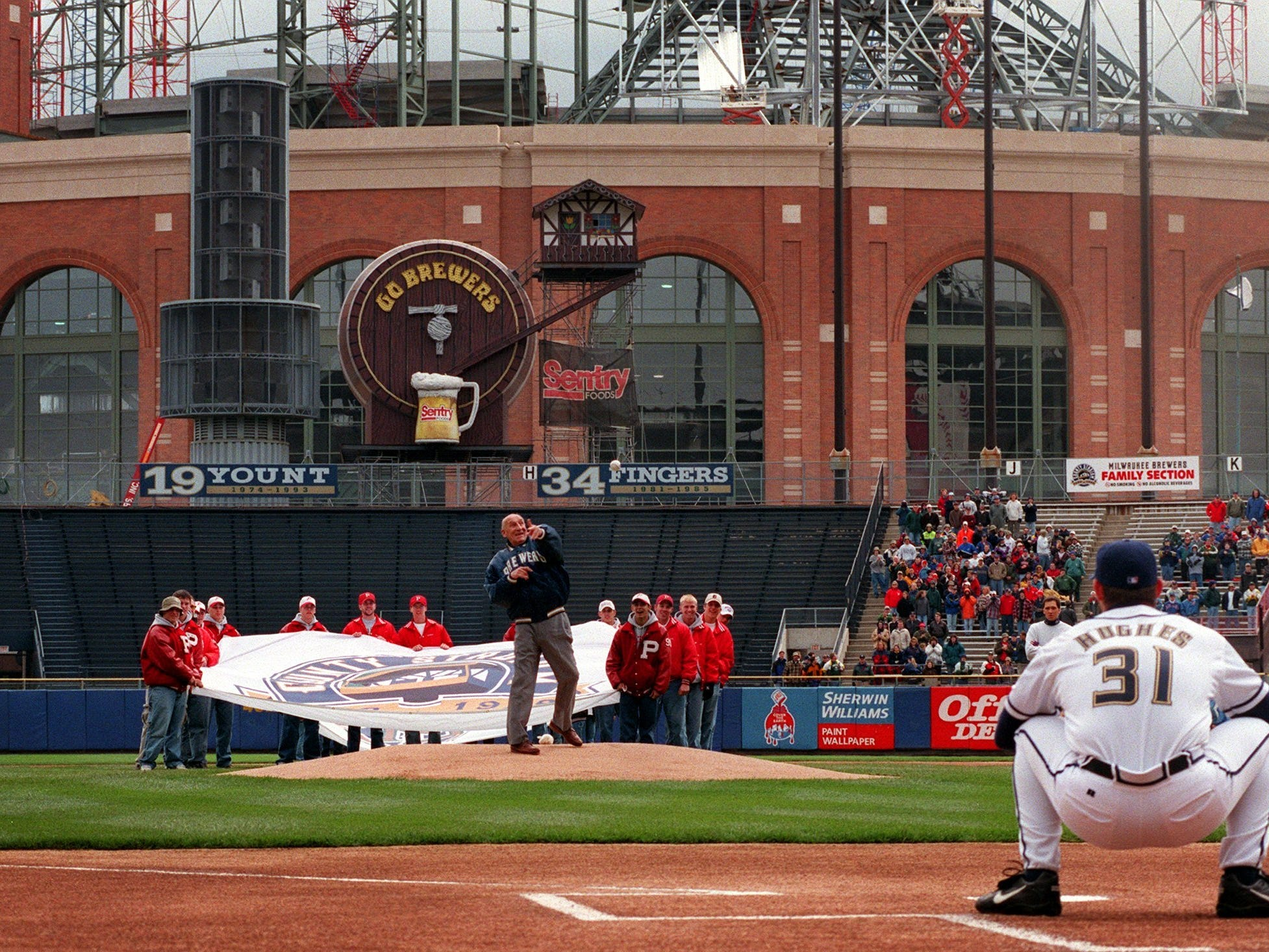 Baseball Hall of Famer Warren Spahn throws out the ceremonial first pitch with Miller Park in the background. The Brewers lost their home opener, 9-4, to the the Chicago Cubs Friday April 16, 1999.