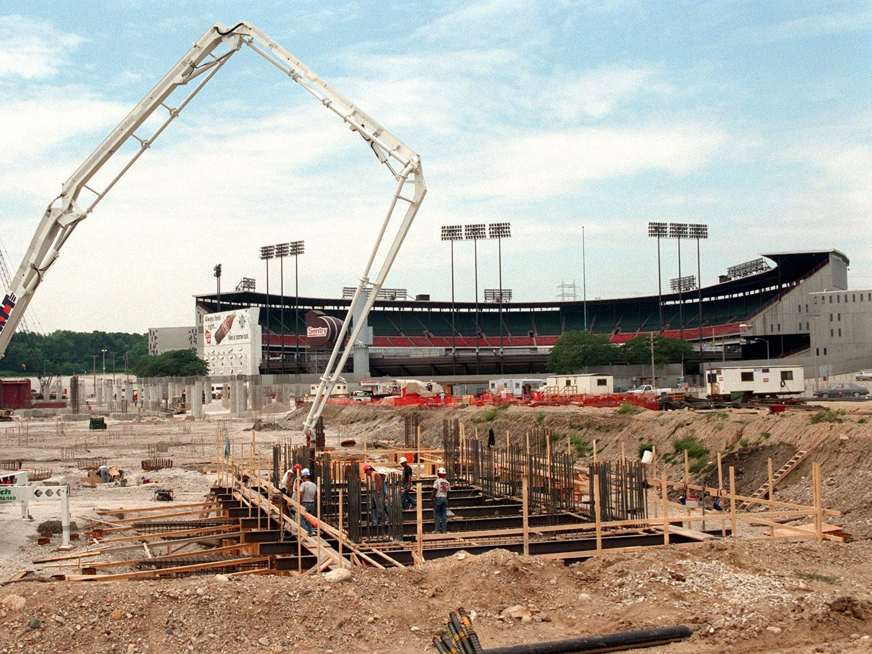 Construction workers pour concrete Wednesday  July 23 1997, in the left field area of Miller Park.