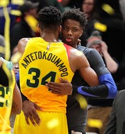 Giannis Antetokounmpo greets his brother and Mavericks rookie forward Kostas Antetokounmpo after the Bucks' victory over Dallas on Monday afternoon at Fiserv Forum.