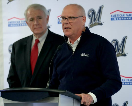 American Family Insurance Chairman and Chief Executive Officer Jack Salzwedel speaks as Milwaukee Mayor Tom Barrett listens during a news conference at Miller Park in Milwaukee on Tuesday.