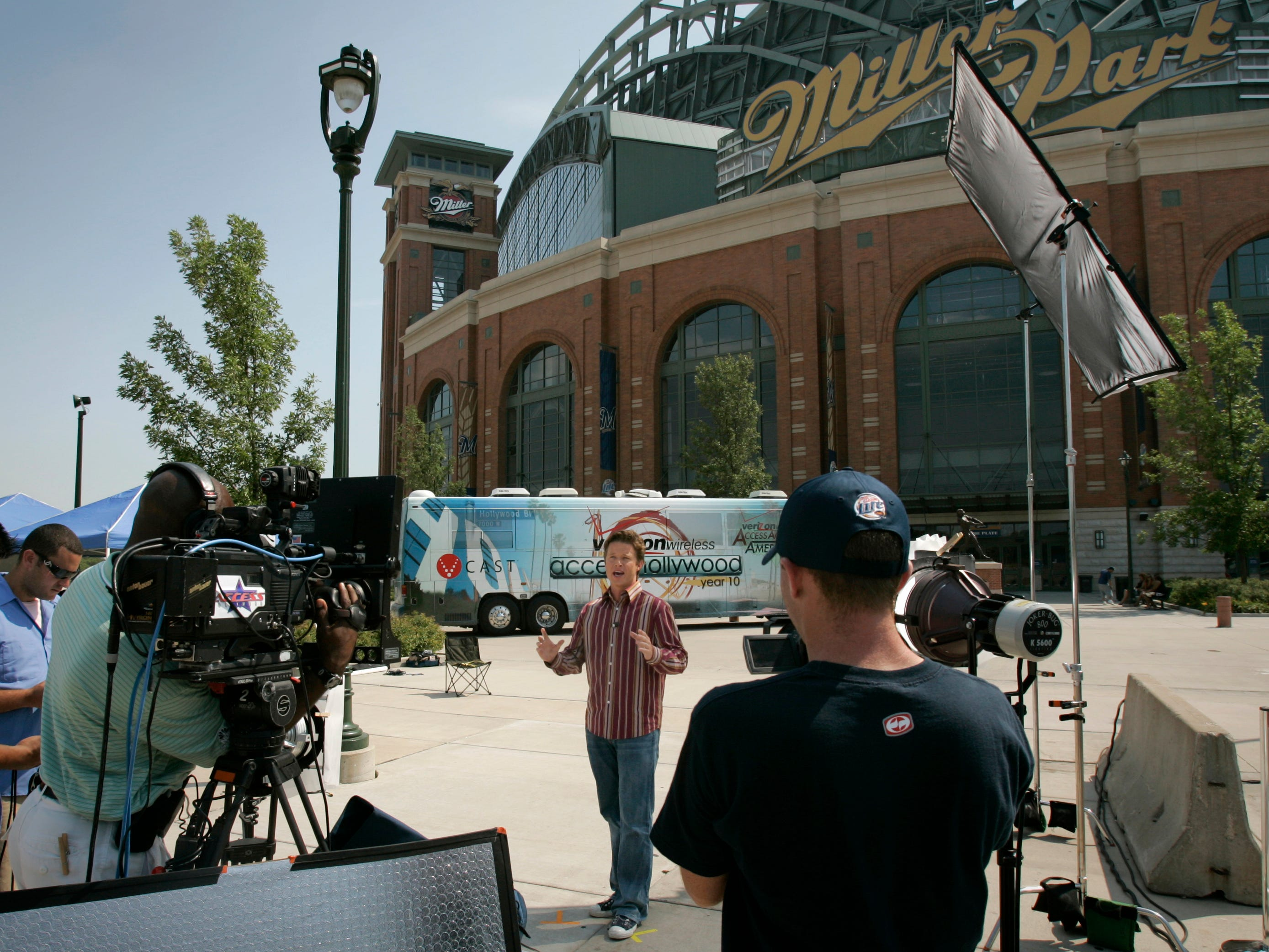 Billy Bush, co-host of the television show Access Hollywood with Nancy O'Dell, and his crew film a segment on Milwaukee in front of Miller Park Wednesday, Sept. 7, 2005.