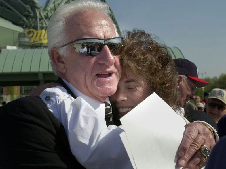 Former Milwaukee Braves player and Brewers radio announcer Bob Uecker gets a hug from Stephanie Widule, daughter of Eddie Mathews, former Milwaukee Braves star. Mathews recently passed away. Widule was on hand for the Granite Braves memorial near Miller Park Wednesday.