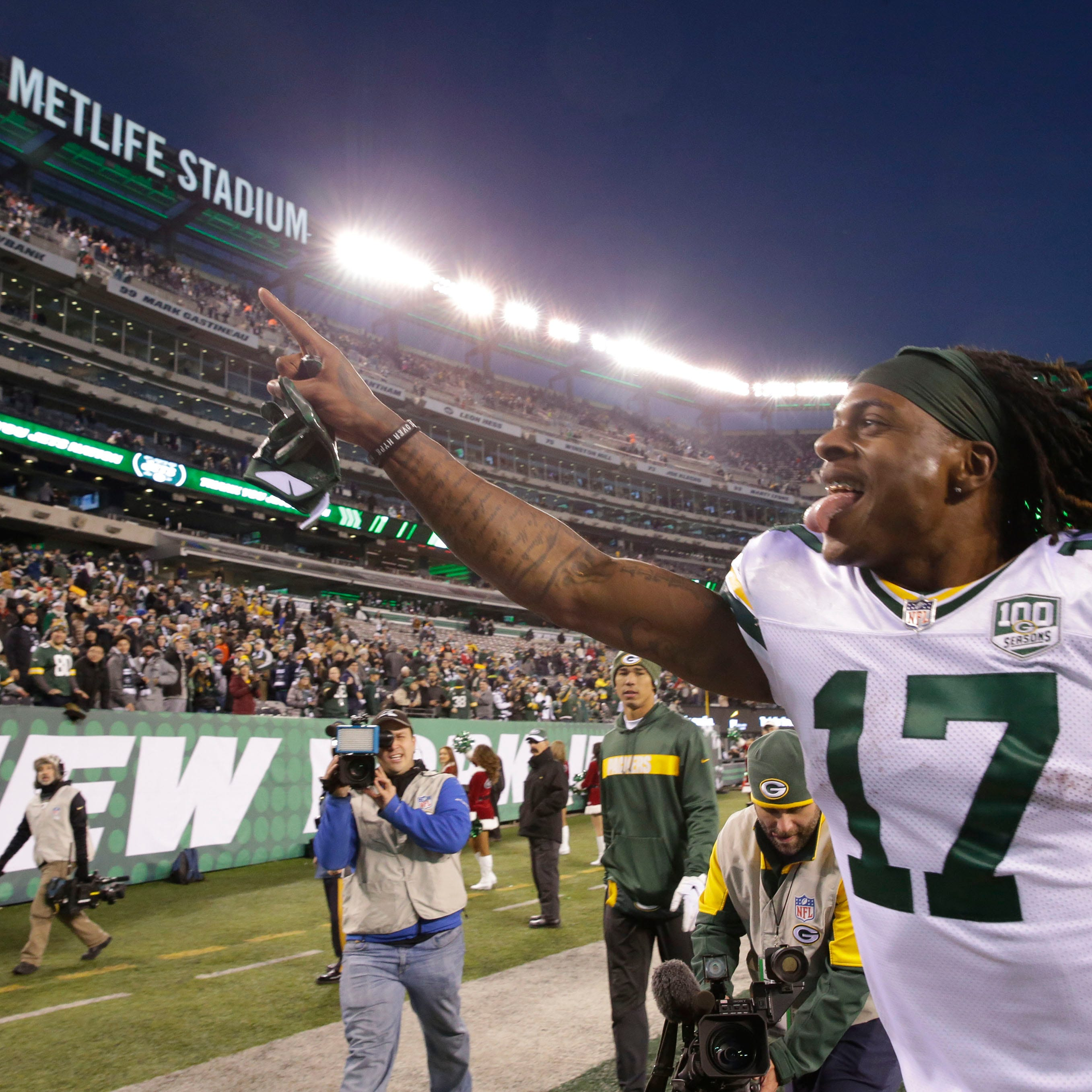 Green Bay Packers' Davante Adams responds to the fans after the Packers 44-38 overtime win against the New York Jets on Dec. 23 at MetLife Stadium  in East Rutherford, New Jersey.