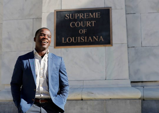 Theo Shaw poses for a photograph outside of the Louisiana State Supreme Court, where he works as a clerk for Chief Justice Bernette Joshua Johnson, in New Orleans. Shaw was one of six black students arrested in the small Louisiana town of Jena in the beating of a white high school student. Unable to post bond, he spent months behind bars but always maintained his innocence. Shaw eventually made the law his life's work and has gone on to intern and work at various legal aid groups and graduated from law school this year.