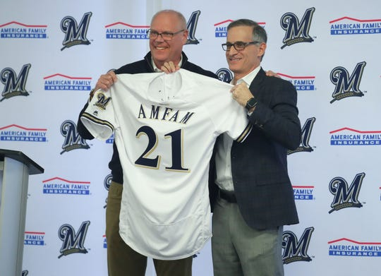 "American Family Insurance Chairman and Chief Executive Officer Jack Salzwedel (left) and Milwaukee Brewers Chief Operating Officer Rick Schlesinger hold up a jersey with ""Amfam"" on the back during a news conference at Miller Park in Milwaukee on Tuesday. MillerCoors said Tuesday it is giving up the naming rights to Miller Park, home of the Milwaukee Brewers baseball team, after 2020. Beginning in 2021, the rights will go to Madison-based American Family Insurance."