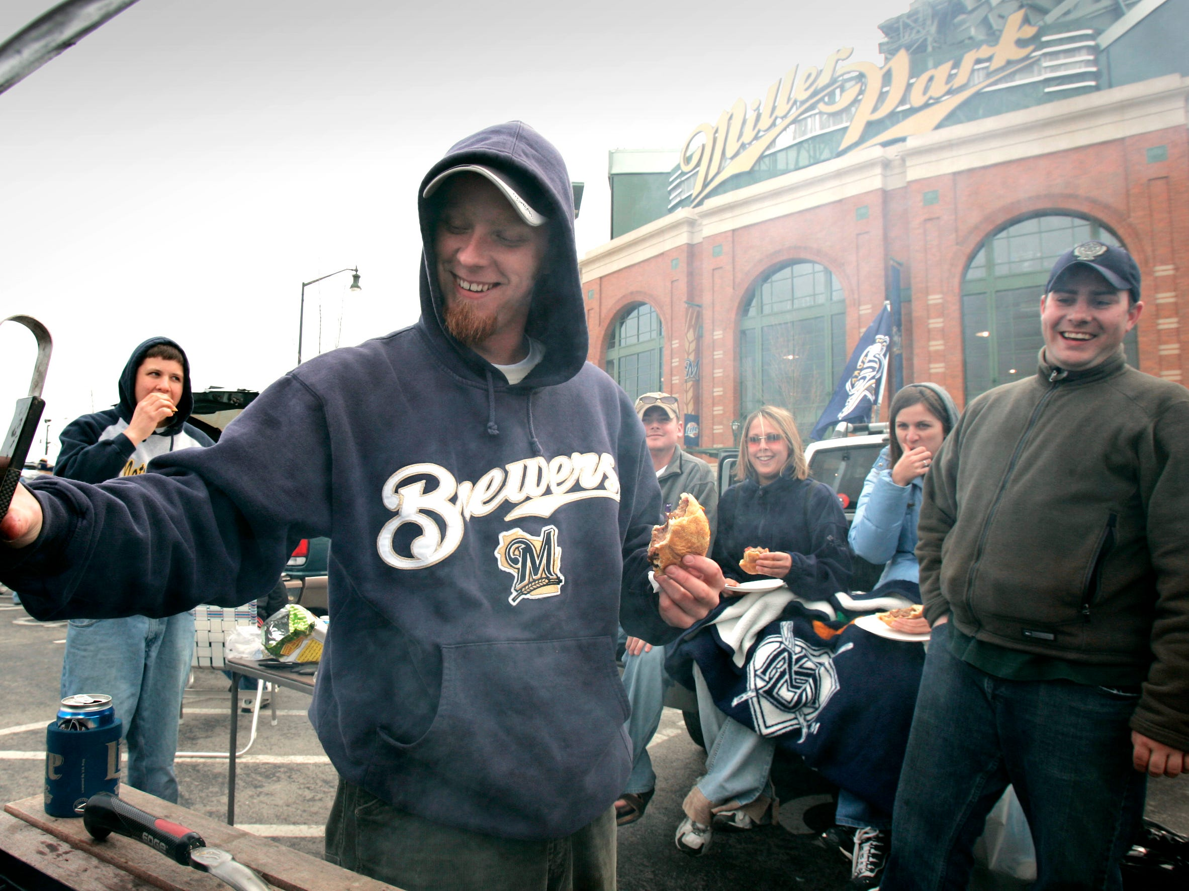 Milwaukee Brewers fan Ryan VandeWalle of Green Bay tailgates before the home opener Monday, April 11, 2005.