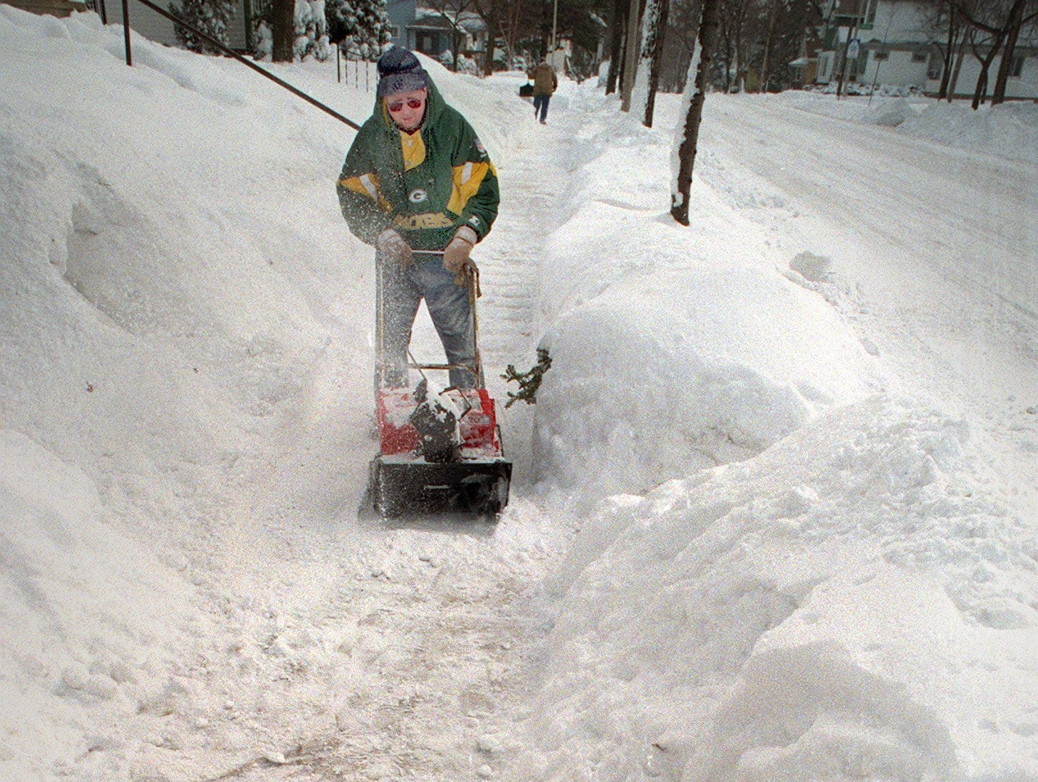 While Milwaukeeans like John Greulich tries to unbury his sidewalk in the 2500 block of S. Superior St. Kayla Sparapane, 11, tunnels in just for the fun of it. The worst blizzard of the past decade?? hit Wisconsin Sat., Jan. 2nd, 1999 and Sunday, Jan. 3rd, found people coping with the 12 to 18?? inches of snow that fell.