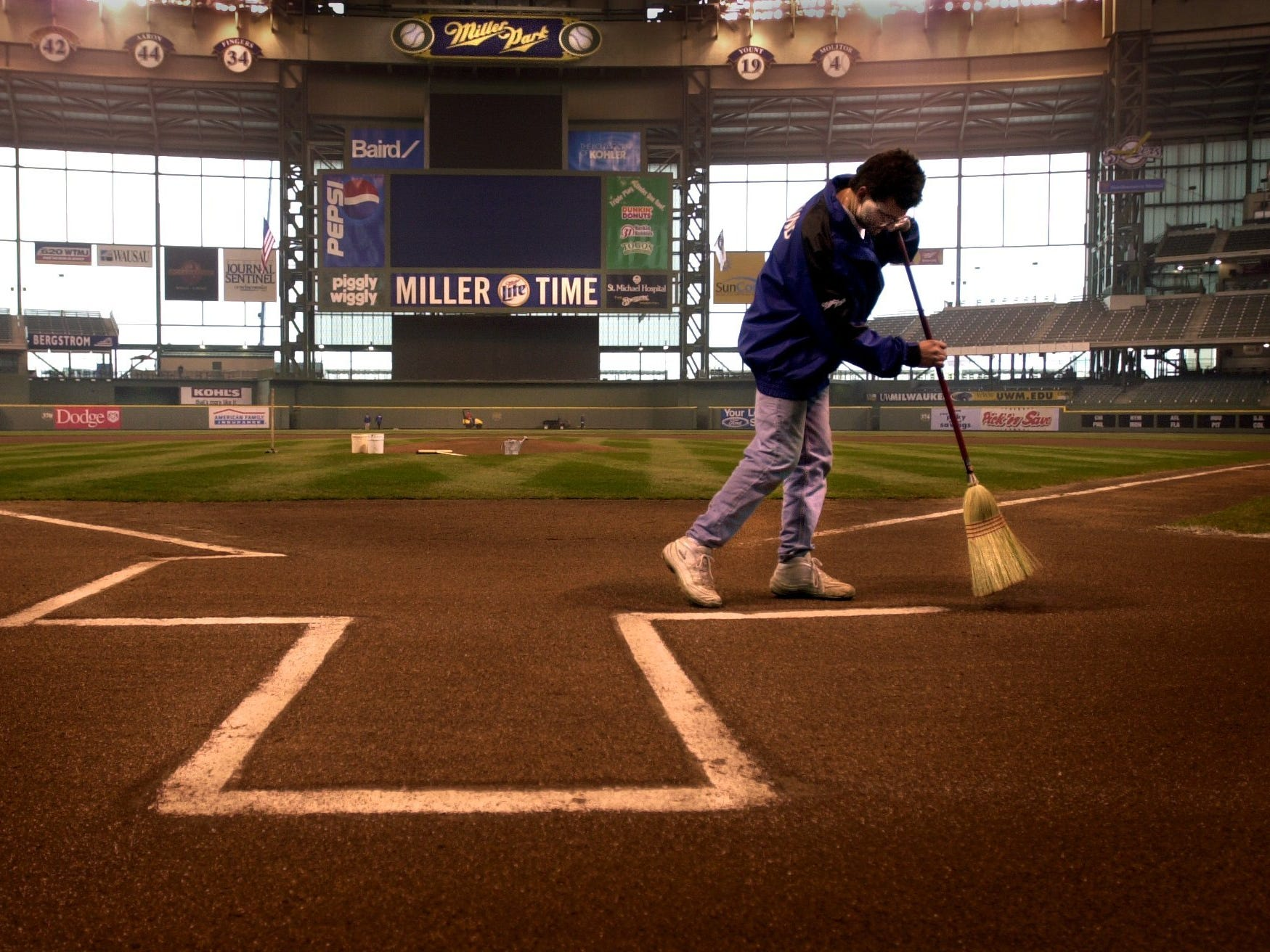 After the area was carefully groomed, home plate was dusted off by Milwaukee Brewers grounds crew member Tom Lund in 2001. The Brewers prepared for their first home opener in Miller Park, against the Reds.