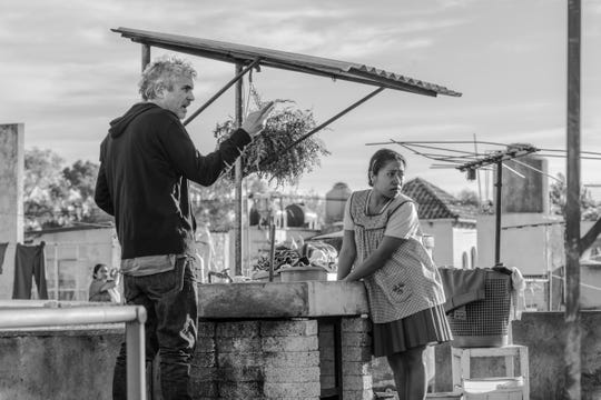 """Roma,"" written and directed by Alfonso Cuaron (left) and starring Yalitza Aparicio, is available on Netflix. The movie received 10 Academy Award nominations, including four for Cuaron and one for Aparicio."