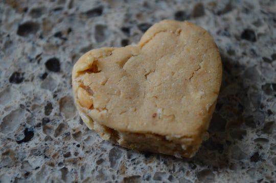 This treat, which is called Calming, helps dogs with anxiety, said Jenny Schwingle, owner of Auntie Jennie's Barkery.