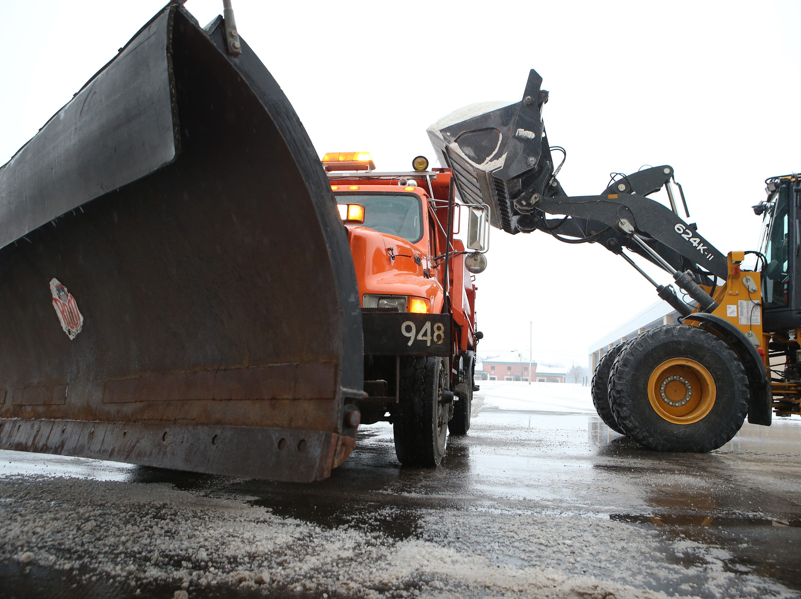 Eight tons of salt is loaded onto a Village of Menomonee Falls plow truck at the Public Works Yard on Good Home Road as snow from the Jan. 22 snowstorm begins to fall. The salt load lasts about one hour of driving one of the Village's snow clearing and salting routes.