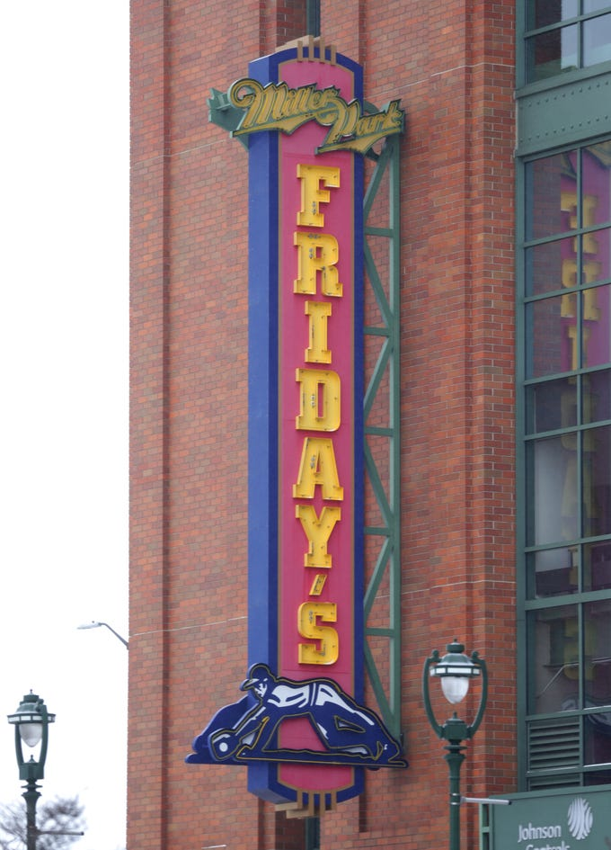 The TGIF Friday's sign features Miller Park signage at Miller Park in Milwaukee on Tuesday, Jan. 22, 2019. MillerCoors said Tuesday it's giving up the naming rights to Miller Park, home of the Milwaukee Brewers baseball team, after 2020. Beginning in 2021, the rights will go to Madison-based American Family Insurance.