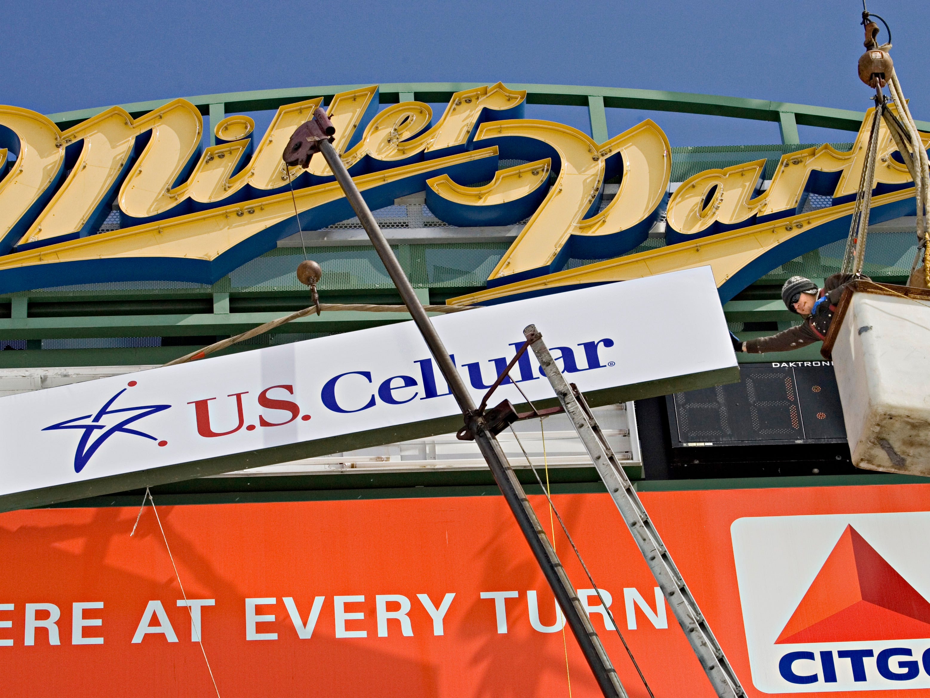 Workers from American Sign Factory of Milwaukee, put  several new advertising signs on the tower outside Miller Park, before the season opens March 24, 2008.