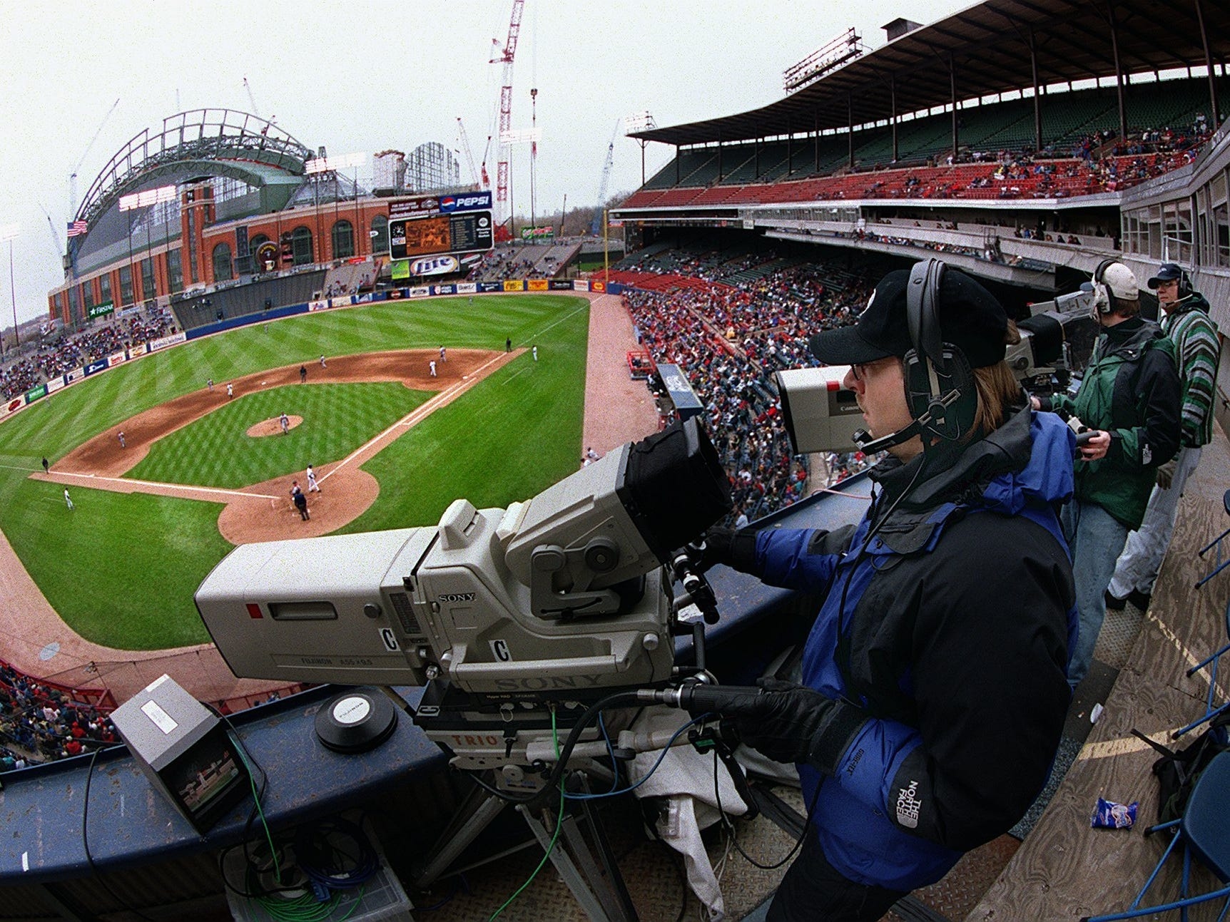 Freelance camera operator Andy Stieber of Milwaukee covers the Brewers-Braves game Saturday, April 15, 2000, at County Stadium in Milwaukee. Stieber had been hired for the day to cover the game for Atlanta-based superstation TBS, home of Atlanta Braves baseball.