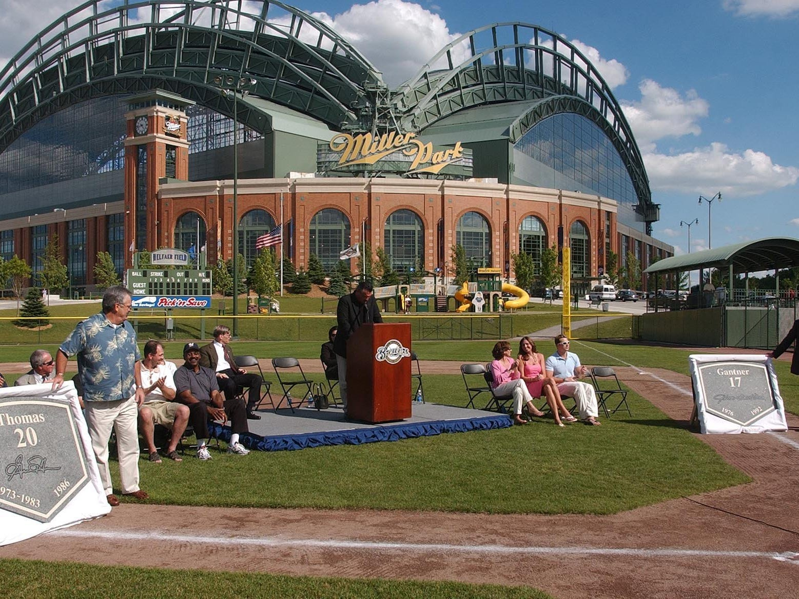 Former Milwaukee Brewers Gorman Thomas (left) and Jim Gantner uncovered their stone that will be placed in the Brewers Walk of Fame during their induction ceremony at Miller Park's Helfaer Field in Milwaukee June 22, 2004.
