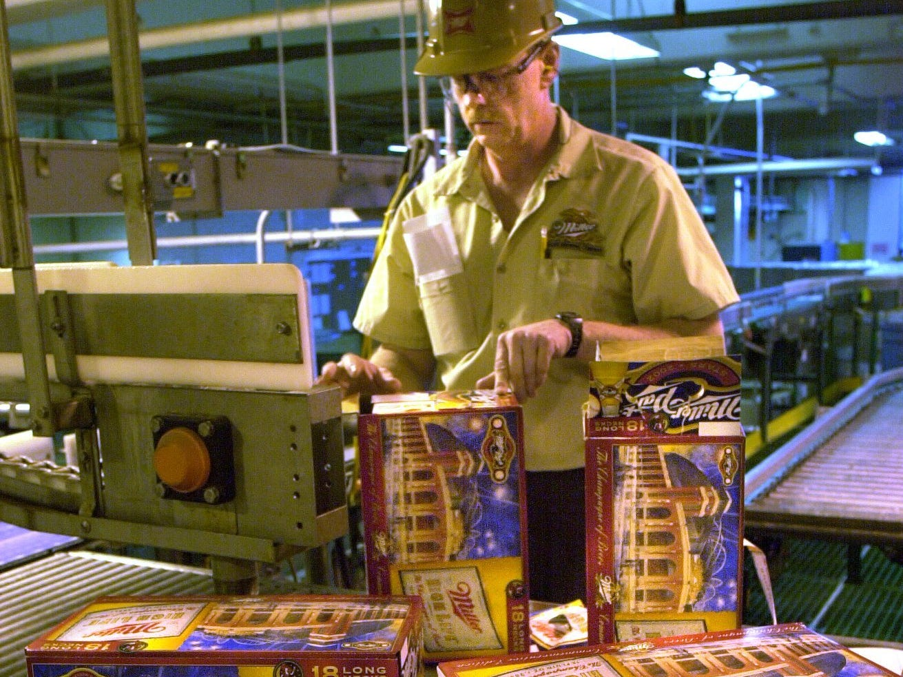 Steve Amundsen performs a first pack inspection as the B-52 line gears up to package special-labeled 18 packs of long necks of Miller High Life in packages depicting Miller Park and the All Star Game.